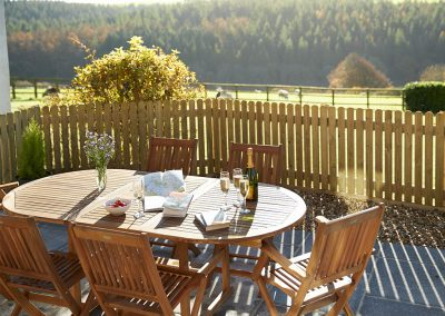 The patio at Green Knowe Cottage, Knowstone