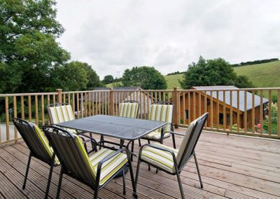 The large decked area @ Hadleigh Lodge with scenic valley views