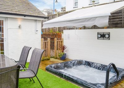 The patio & hot tub at Harbour Hideaway, Ilfracombe