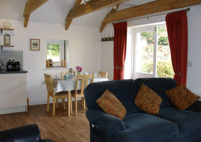 The open plan living & dining area at Hideaway Barn, Charlestown