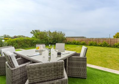 The grassed patio & garden at Highcroft, St Miniver
