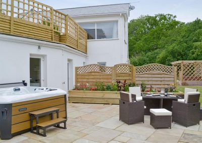 The hot tub & patio at Honey Pippin, Horselake Farm Cottages, Cheriton Bishop