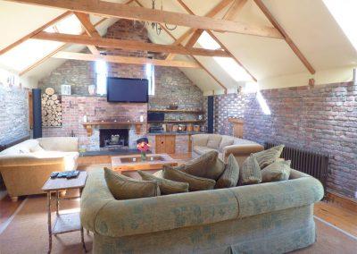 The living room at Hybadore Coach House, Golant