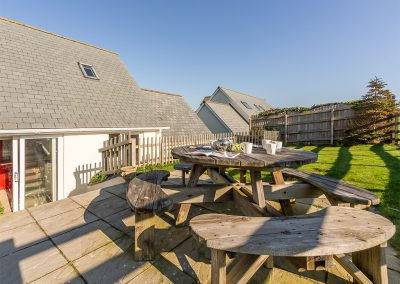 The patio, barbecue area & garden at Jalousie, Polzeath