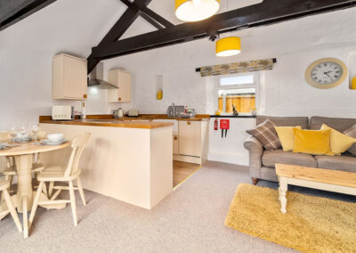 The living area & kitchen at Jasmine Cottage, Old Mill Cottages, Marldon