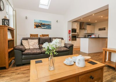 The open-plan living & dining area at Keepers Cottage, Stoneleigh Holiday Village, Weston