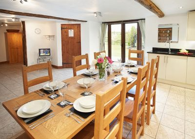 The dining area at Harvest Moon, Lower Curscombe Barn, Feniton