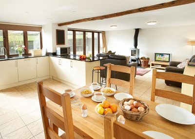 The dining area at Hunters Moon, Lower Curscombe Barn, Feniton