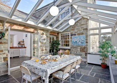 The conservatory dining area at Lower Margate, Fletchersbridge