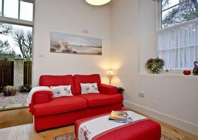 The open-plan living area at Magnolia Cottage, Cockington Cottages, Cockington
