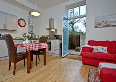 The open-plan living & dining area at Magnolia Cottage, Cockington Cottages, Cockington