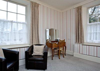 The bedroom at Magnolia Cottage, Cockington Cottages, Cockington