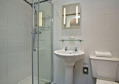 The en-suite shower room at Magnolia Cottage, Cockington Cottages, Cockington