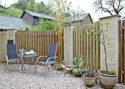 The enclosed gravel courtyard at Magnolia Cottage, Cockington Cottages, Cockington
