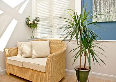 The conservatory sitting area at Mallock, Cockington Cottages, Cockington