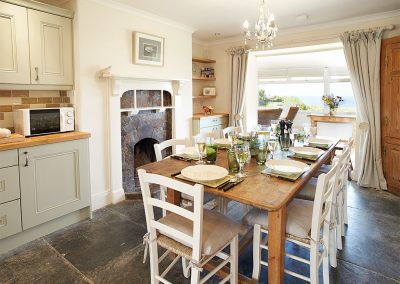 The dining area at Merlins Cottage, Trevellick
