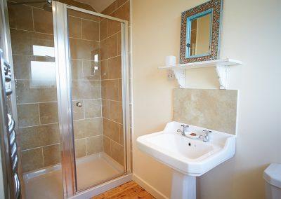 Bedroom #1 en-suite at Merlins Cottage, Trevellick