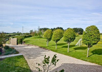 The large manicured lawn at Mowhay Barn, St Ervan