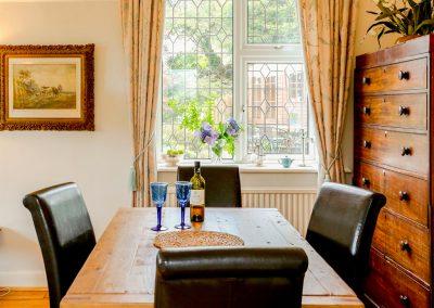The dining area at Muddykins Cottage, Muddiford