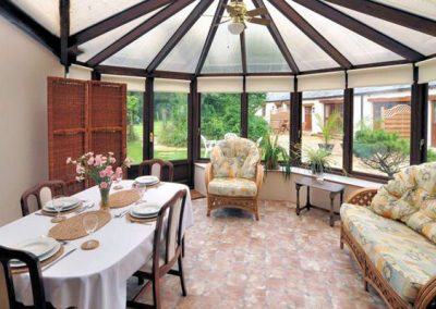 The dining area in the conservatory @ Park Mill Farm Cottage