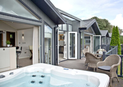 The hot tub & wrap-around deck at Parracombe Lodge, Kentisbury Grange, Kentisbury