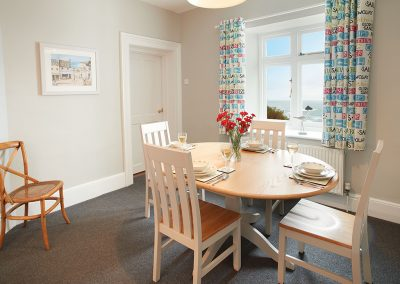 The dining area at Pelorus Cottage, Trevose Head Lighthouse, Trevose