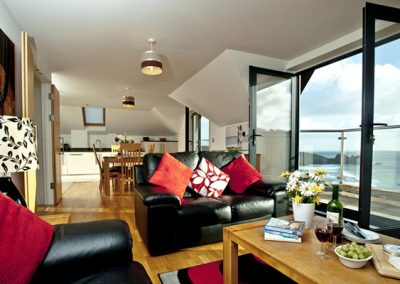 The living area opens onto a balcony @ The Penthouse, Porthcurno, Penzance