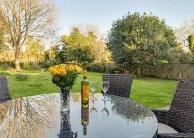 The patio & rear garden at Pentire, Marldon