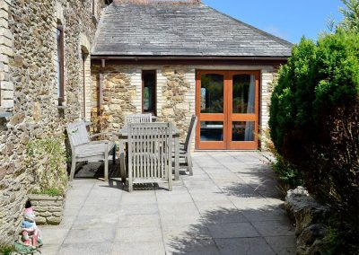 The patio at Penty Rosen, Rescorla Farm Cottages, Rescorla