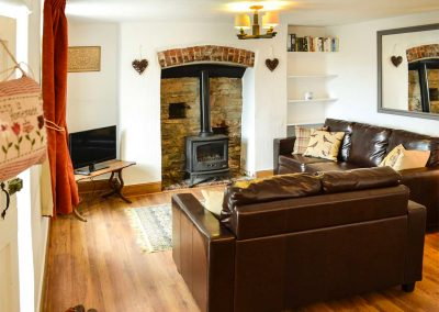 The living area at Pheasant Cottage, Watermouth