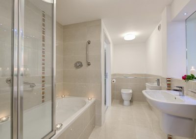 Bedroom #1 en-suite & family bathroom at Porth House, Mawgan Porth