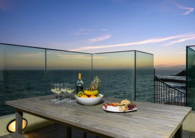 Enjoy awesome sunset sunset views from the upper terrace at Porthleven Glass House, Porthleven