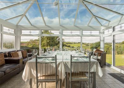 The dining area in the conservatory at Ridge House, Higher Gabwell
