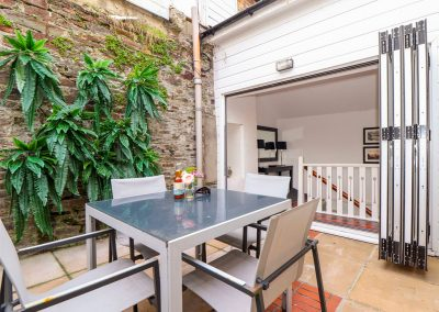 The sun-drenched patio at Rock House, Trebarwith Strand