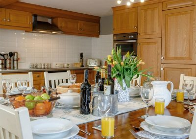 The farmhouse style kitchen & dining area at Rocombe Thatch, Higher Gabwell