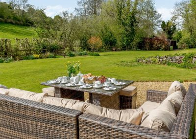 The sitting out area & garden at Rocombe Thatch, Higher Gabwell