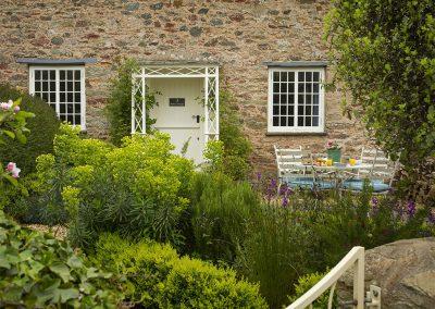 The front patio & delightful garden at Rose Cottage, Ashprington