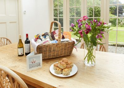 The dining area with welcome hamper at Rosemundy Villa, St Agnes