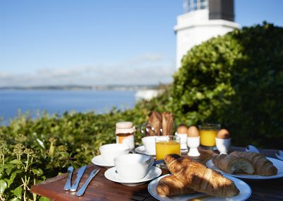 Enjoy breakfast on the patio at Sally Port Cottage, St Anthony
