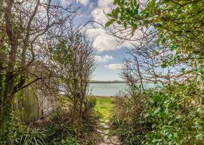 At Schoopers, Porthilly the large garden & woods lead down to the shore