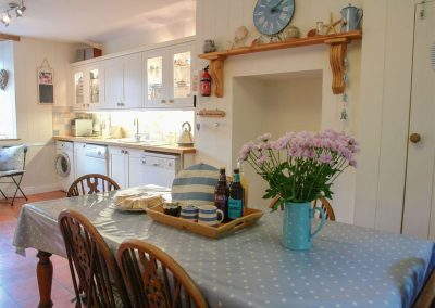 The farmhouse-style kitchen & dining area at Sea Thrift, St Agnes