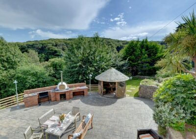The outdoor kitchen, alfresco dining area & thatched garden turret at Seaglass, Watermouth