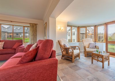 The living area & conservatory at September Cottage, Roserrow, Polzeath