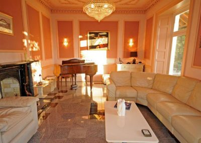 The spacious living area @ Singleton Manor, Torquay complete with a baby grand piano