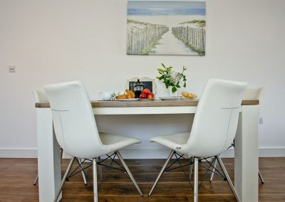 The dining area at Sunnymead Penthouse, Exmouth