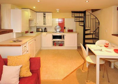 The open-plan kitchen & dining area @ Sweet Rose, Old Manor Farm, Torquay