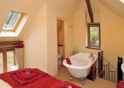 The bedroom @ Sweet Rose, Old Manor Farm with roll top bath