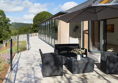 The balcony overlooking the beautiful garden & river at Teign Vale, Drewsteignton