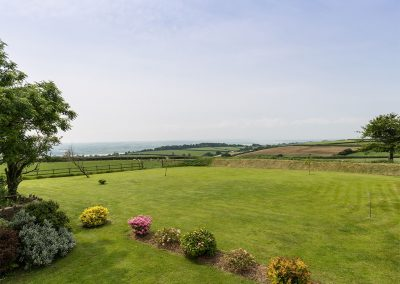 The garden & view of rolling fields at The Abandoned Cottage, Prixford