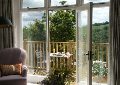The balcony at The Artist's Studio, Widworthy has a fantastic view across rolling Devon hills